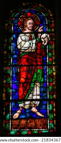 LEON, SPAIN - JULY 17, 2014: Stained glass window depicting Jesus Christ in the Basilica of San Isidoro in Leon, Castille and Leon, Spain.