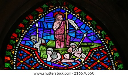 LEON, SPAIN - JULY 17, 2014: Stained glass window depicting Jesus rising from the grave in the cathedral of Leon, Castille and Leon, Spain.