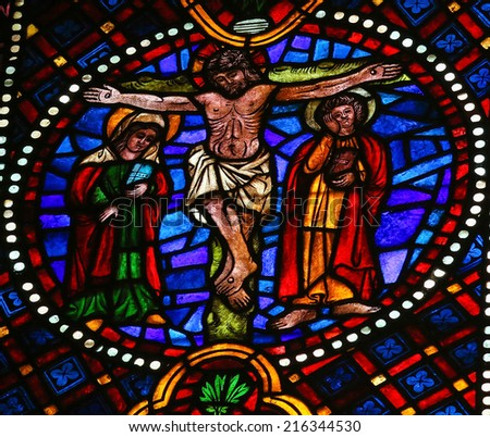 LEON, SPAIN - JULY 17, 2014: Stained glass window depicting The Crucifixion of Jesus on Good Friday in the cathedral of Leon, Castille and Leon, Spain. - stock photo