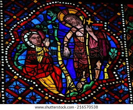 LEON, SPAIN - JULY 17, 2014: Stained glass window depicting the resurrected Jesus and Mother Mary in the cathedral of Leon, Castille and Leon, Spain. - stock photo