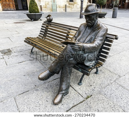 LEON, SPAIN - MAR 23, 2015: Bronze statue of Antonio Gaudi in Leon by Jose Luis Fernandez, his work Against House Treads, is the only building designed and built by GaudÃ?i in the city of Leon. - stock photo
