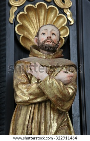 LEPOGLAVA, CROATIA - SEPTEMBER 21: Saint Dominic on the altar of Our Lady of Sorrows, parish Church of the Immaculate Conception of the Virgin Mary in Lepoglava, Croatia on September 21, 2014 - stock photo