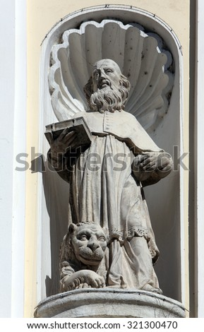 LEPOGLAVA, CROATIA - SEPTEMBER 21: Saint Jerome on the portal of Holy Cross, parish Church of the Immaculate Conception of the Virgin Mary in Lepoglava, Croatia on September 21, 2014 - stock photo