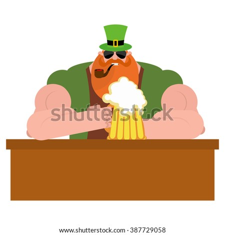 Leprechaun drinking beer. Big and serious leprechaun at  bar holds pint of ALE. Powerful magical midget with  big Red Beard. Green frock coat and hat cylinder. Irish holiday St. Patrick's day - stock photo
