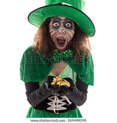 Leprechaun with a gold treasure in her Hands, isolated on white, concept legends and myth