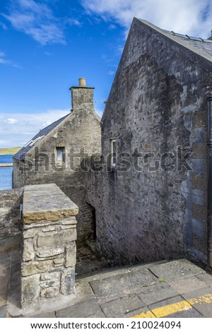Lerwick, Shetland, Scotland, United Kingdom.Old buildings dating from the 17th century near the port.Street View of the old city of 400 years with its characteristic granite houses in northern Europe.