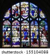 LES ANDELYS, FRANCE - AUGUST 12: The 16th century stained glasses, describing scenes of the Saints' lifes of the Collegiate Church of Notre-Dame in Les Andelys on August 12, 2013 in Normandy. - stock photo