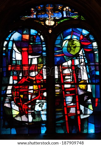 "LES BAUX-DE-PROVENCE, FRANCE - MAY 16, 2013:  Abstract stained glass window  in Saint Vincent's Church in Les Baux-de-Provence, one of ""The Most Beautiful Villages of France"". - stock photo"