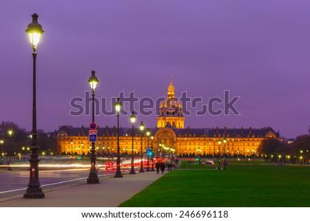 Les Invalides at night illumination in Paris, France - stock photo