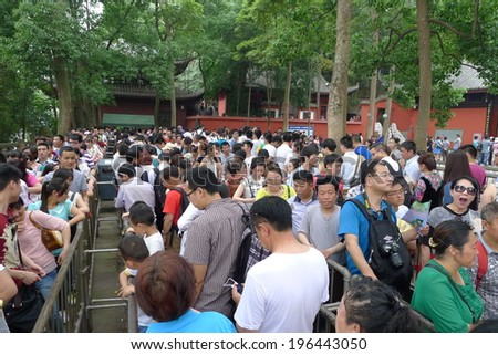 LESHAN, CHINA - MAY 24: Unidentified believers line up a long queue and wait to visit the UNESCO world heritage Giant Buddha, Leshan, Sichuan, China, May 24, 2014