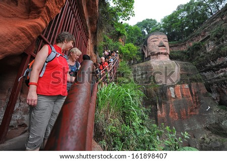 LESHAN, CHINA - OCT 7: tourists visit world's largest Buddha during Chinese National holiday on October 7, 2012 in Leshan, China. During this holiday around 740 million trips will be made by Chinese people.