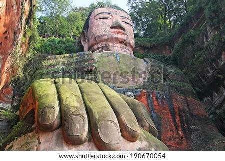 Leshan Giant Buddha is the largest stone Buddha in the world, 71 metres (233 feet) tall; Unesko World Heritage Site. Canon 5D. - stock photo
