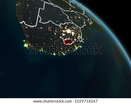 Lesotho from orbit of planet Earth at night with visible borderlines and city lights. 3D illustration. Elements of this image furnished by NASA.