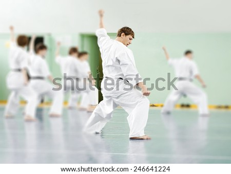 Lesson in karate school for adults and children - stock photo