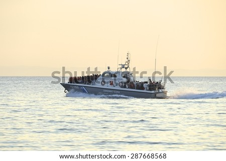 LESVOS, GREECE- JUNE 11, 2015. A Greek Coastguard ship having picked up refugees who have crossed from Turkey to Europe near Mytilene, Lesvos on June 11, 2015. Lesvos is now a hot spot for migrants. - stock photo
