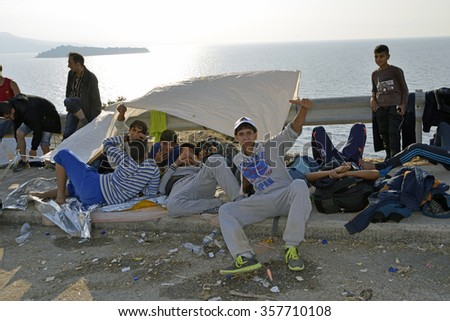 LESVOS, GREECE - OCTOBER 05, 2015. Refugee migrants, arrived on Lesvos in inflatable dinghy boats, they stay in refugee camps waiting for the ferry to mainland Athens.