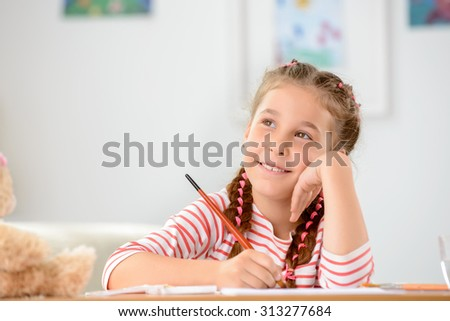 Let me think. Pleasant cheerful little girl holding pencil and thinking about picture while going to paint - stock photo