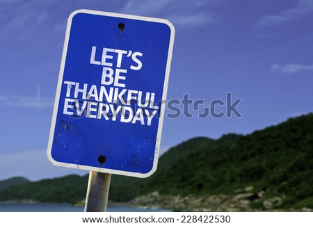 Let's Be Thankful Everyday sign with a beach on background