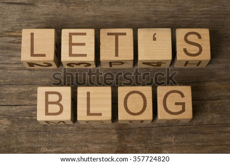Let's Blog text on a wooden cubes