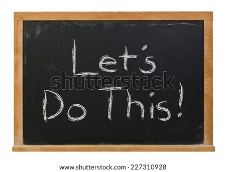Let's do this written in white chalk on a black chalkboard isolated on white - stock photo