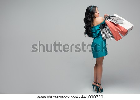 Let's go shopping! happiness, consumerism, sale and people concept - smiling young woman with shopping bags  - stock photo