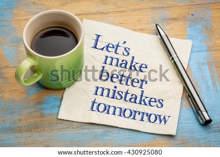 Let's make better mistakes tomorrow - handwriting on a napkin with a cup of espresso coffee