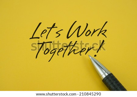 Let's Work Together! note with pen on yellow background - stock photo