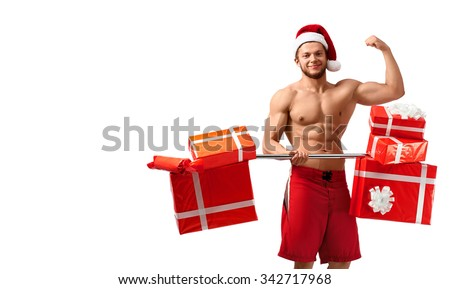 Let us train together. Studio shot of a toned shirtless Santa Claus after a workout with barbell full of gift boxes copyspace on the side  - stock photo