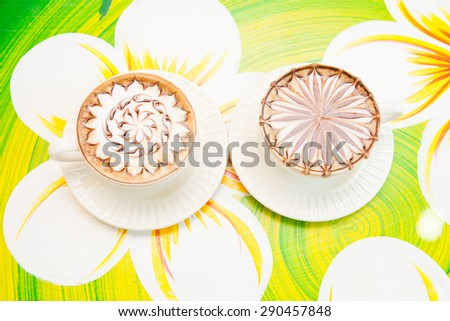 Lette art coffee in a white cup. - stock photo