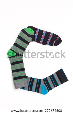Letter C  made from colorfull socks isolated on white - stock photo
