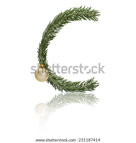 Letter C made from fir branches, decorated with christmas balls and reflection. - stock photo