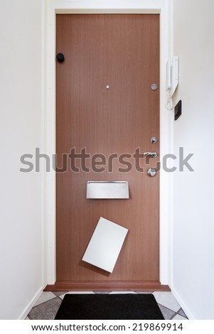 letter comes through mailbox - stock photo
