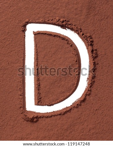 Letter D uppercase made of cocoa powder - stock photo