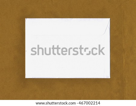 Letter envelope for mailing over brown background