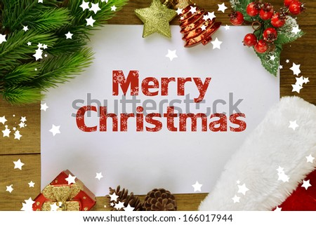 Letter for Santa with Christmas hat on table close-up - stock photo