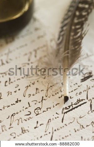 Letter handwritten in cursive with quill pen. Brown ink on yellowish paper with visible grainy structure. - stock photo