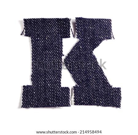 Letter K. Jeans alphabet Isolated on White. Handmade font. - stock photo