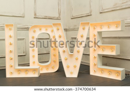 Letter LOVE for sign with light bulbs - stock photo
