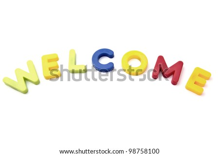 "Letter magnets "" welcome"" closeup on white background"