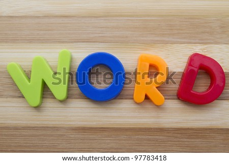 """Letter magnets """"WORD"""" closeup on wood background - stock photo"""