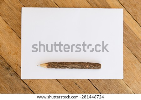 letter, message, mail and  inspiration concept - white blank paper sheet with wooden pen on table  - stock photo