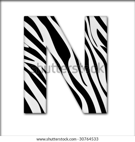 Letter N from the alphabet. Made of animal print. It has a clipping path. - stock photo