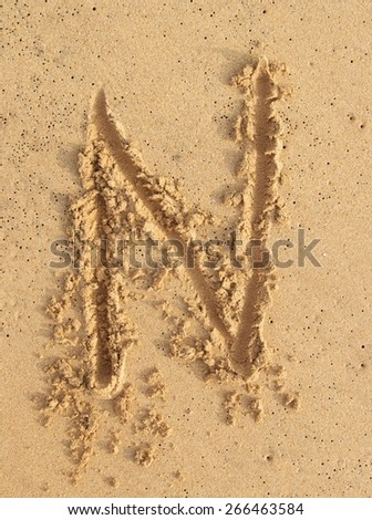 """letter """"N"""" in the sand - stock photo"""