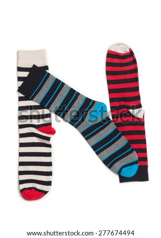Letter N  made from colorfull socks isolated on white - stock photo