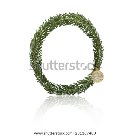 Letter O made from fir branches, decorated with christmas balls and reflection. - stock photo