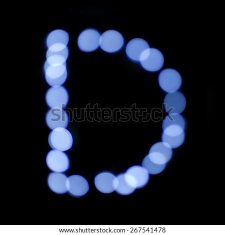 "letter of Christmas lights on a dark background, the letter D, ""blue bokeh"" - stock photo"