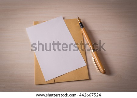 Letter on a wood table with pen
