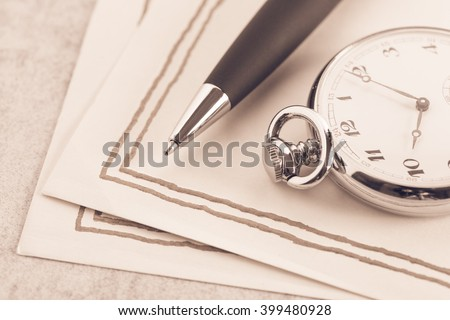 Letter paper, vintage pocket watch and pen. Concept of writing, correspondence and old fashioned communication. - stock photo