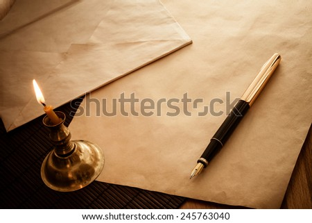 Letter, pen and candle. vintage style