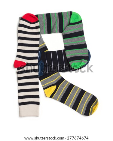 Letter  R made from colorfull socks isolated on white - stock photo